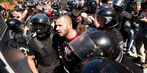 Policemen detain opponents of a gay rights march, in Kiev, Ukraine, Saturday, June 6, 2015. Opponents of a gay rights march h