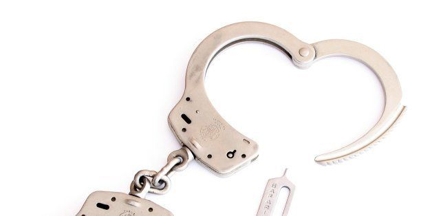 Smith & Wesson Handcuffs with Safariland handcuff key.