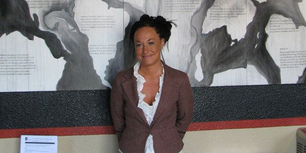 FILE - In this July 24, 2009, file photo, Rachel Dolezal, a leader of the Human Rights Education Institute, stands in front o
