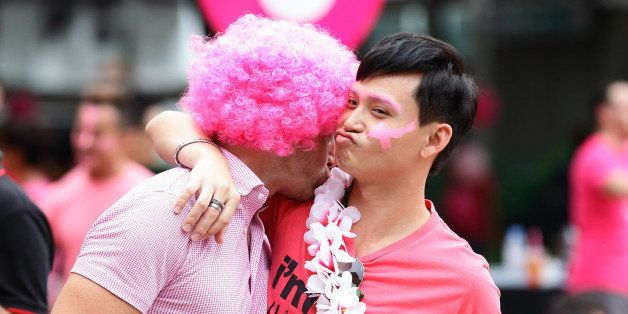 SINGAPORE - JUNE 13:  Participants dress in various shades of pink mingle during the 'Pink Dot SG' event at Hong Lim Park on