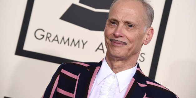 John Waters arrives at the 57th annual Grammy Awards at the Staples Center on Sunday, Feb. 8, 2015, in Los Angeles. (Photo by