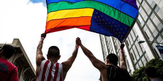 SAN FRANCISCO, CA- JUNE 28: Paulo Torres, left, dances with his husband, Victor Tsang, right, after the San Francisco Gay Pri