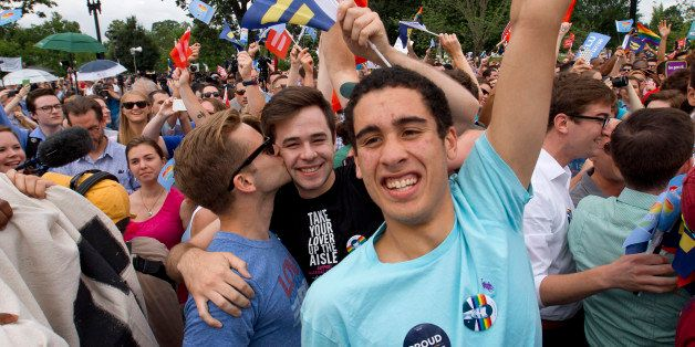 Supporters of same-sex marriage celebrate outside of the Supreme Court in Washington, Friday June 26, 2015, after the court d