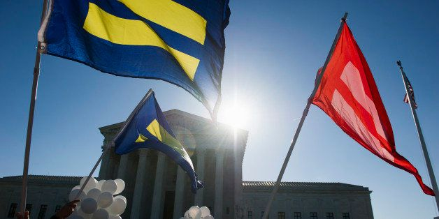 Equality flags fly in front of the Supreme Court in Washington, Tuesday, April 28, 2015. The Supreme Court is set to hear his