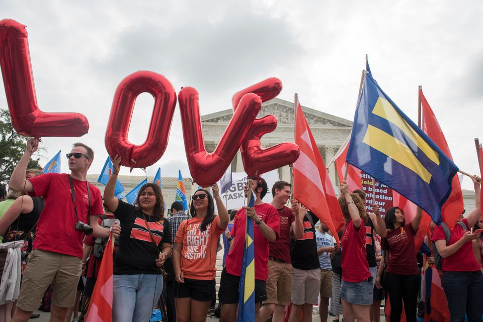 IMAGE DISTRIBUTED FOR HUMAN RIGHTS CAMPAIGN - Marriage equality supporters rally on the steps of the Supreme Court as they wa