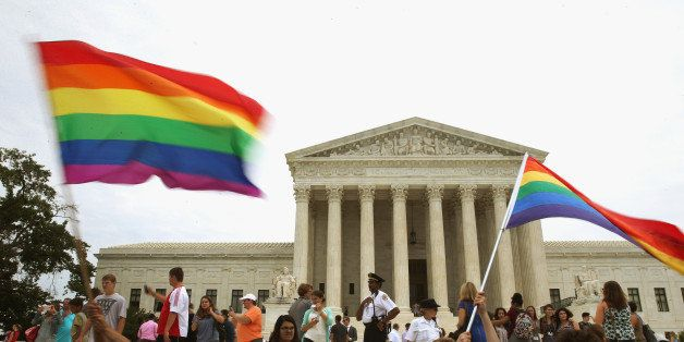 WASHINGTON, DC - JUNE 26:  People celebrate in front of the U.S. Supreme Court after the ruling in favor of same-sex marriage