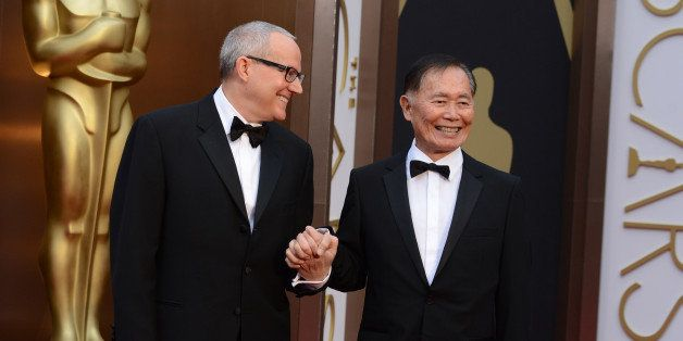 Brad Altman and George Takei arrive at the Oscars on Sunday, March 2, 2014, at the Dolby Theatre in Los Angeles.  (Photo by J