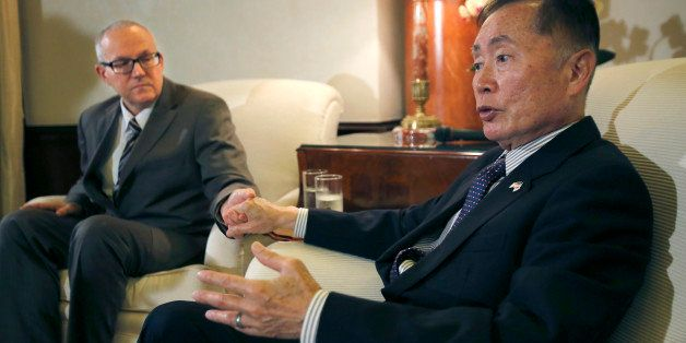 George Takei, right, speaks with his husband Brad Altman during an interview before a reception at U.S. Ambassador to Japan C
