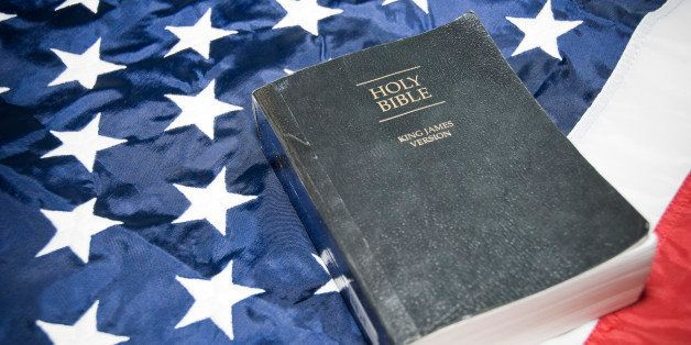 Close-up of holy bible on flag of America.