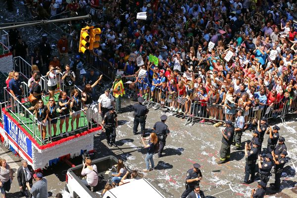 Members of the U.S. women's World Cup championship soccer team ride on a float during a ticker tape parade honoring the team