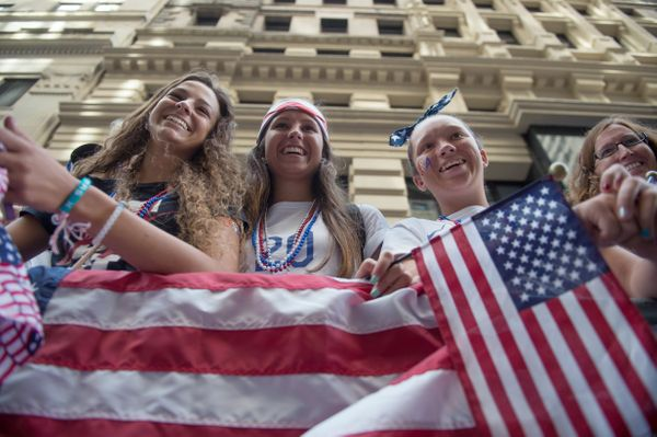 From left to right, Taylor George, Mackenzie Frail and her sister Kirsten Frail of Middletown, Del., look on as the U.S. Wome