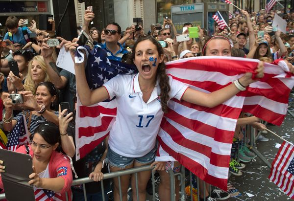 Lucie Keleman of New York's Westchester County cheers as U.S. Women's World Cup soccer champions make their way up Broadway t