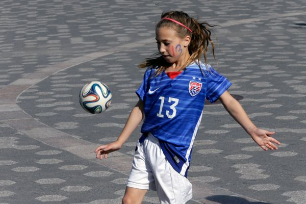 Caigan Leonard, 9, of New Windsor, N.Y., wears a number 13 soccer jersey like team USA player Alex Morgan while waiting for t