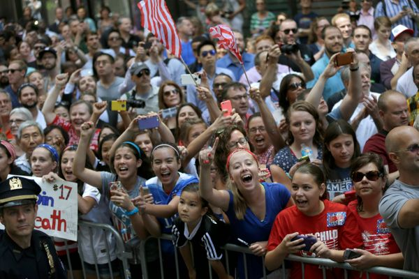 U.S. women's soccer team fans cheer as the players make their way up Broadway's Canyon of Heroes during the ticker tape parad