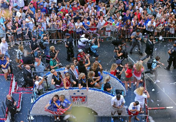 New York Governor Andrew Cuomo, at center on float, gestures during a ticker tape parade for the U.S. women's World Cup socce