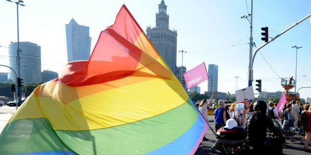 A biker with a multicolor flag attends the annual gay pride parade in Warsaw, Poland, Saturday, June 13, 2015. Gay rights act