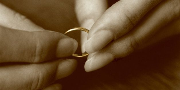 Female hands holding wedding ring