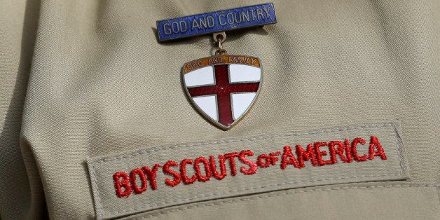File - In this Feb. 4, 2013 file photo, shows a close up detail of a Boy Scout uniform worn during a news conference in front of the Boy Scouts of America headquarters in Irving, Texas. Attorneys for the Boy Scouts of America have reached a settlement with a former San Antonio Scout who says he was abused by his adult leader. (AP Photo/Tony Gutierrez, File)