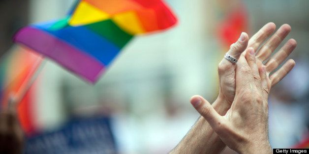 LGBT rinbow flag and clapping hands.