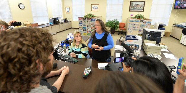 Rowan County Clerk Kim Davis, center, talks with protesters following her office's refusal to issue marriage licenses at the