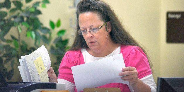Rowan County Clerk Kim Davis performs her job at the Rowan County Courthouse in Morehead, Ky., Tuesday, Aug. 18, 2015. Davis