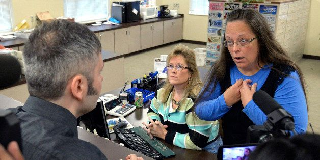 Rowan County Clerk Kim Davis, right, talks with David Moore following her office's refusal to issue marriage licenses at the
