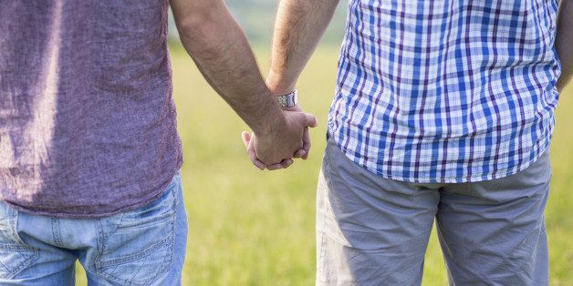 Close up of Gay couple holding hands outdoor