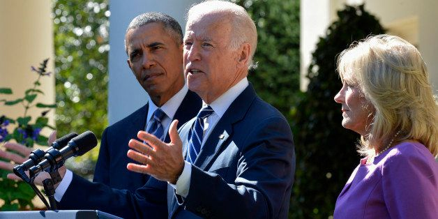 U.S. Vice President Joseph 'Joe' Biden, center, speaks in the Rose Garden of the White House with his wife Jill Biden, right,