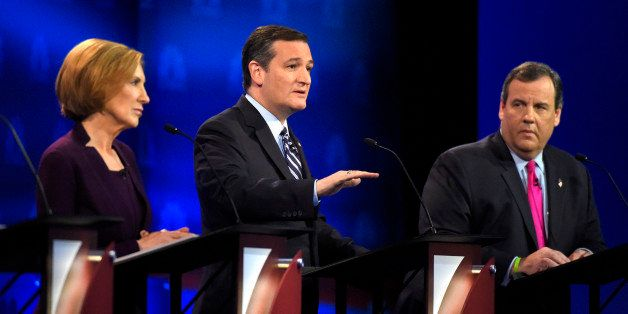 Ted Cruz, center, speaks as Carly Fiorina, left, and Chris Christie listen during the CNBC Republican presidential debate at