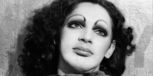 Andy Warhol transvestite Superstar Holly Woodlawn, acclaimed for her performance in 'Trash', photographed in her Greenwich Vi