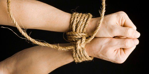 Wrists tied together with rope