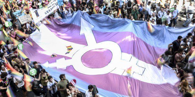 People hold a giant transgender flag during a gay parade on Istiklal Street, the main shopping corridor in Istanbul, on June