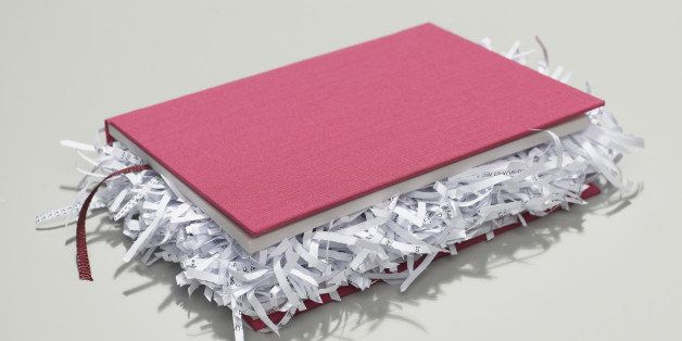 book with shredded pages closed on desk