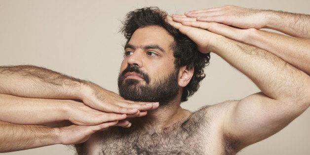 hairy chest, beard, curly black hair, arms, hands, beige background, hairy arms, vogue pose, fashion, studio lit, skin,