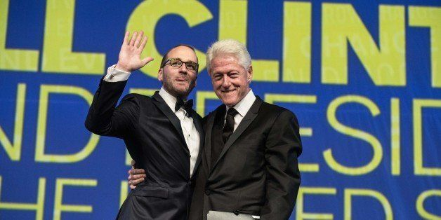 Former US president Bill Clinton (R) and Human Rights Campaign (HRC) president Chad Griffin acknowledge the crowd as Clinton