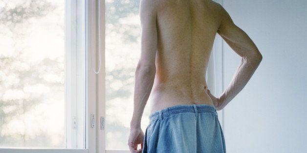 Man standing near a window