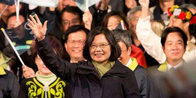 TAIPEI, TAIWAN - JANUARY 16:  President-elect Tsai Ing-wen waves supporters at DPP headquarter on January 16, 2016 in Taipei,