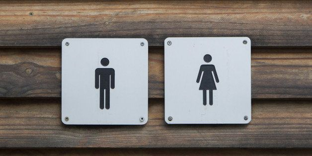 Man and a lady toilet sign, metal on wood
