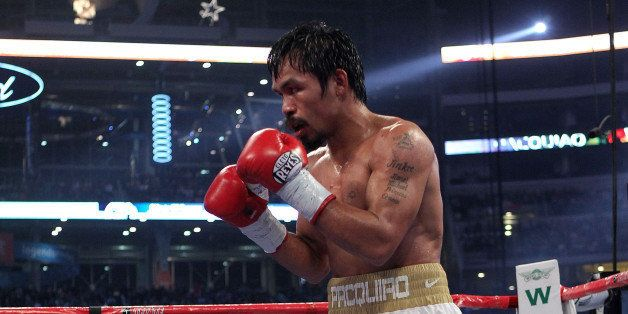 ARLINGTON, TX - NOVEMBER 13:  Manny Pacquiao (white trunks) of the Philippines fights against Antonio Margarito of Mexico dur