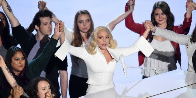 HOLLYWOOD, CA - FEBRUARY 28:   Singer-songwriter Lady Gaga (C) performs onstage during the 88th Annual Academy Awards at the