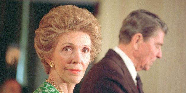 (Original Caption) Washington: First lady Nancy Reagan cast a pensive glance as President Reagan addresses a group of high sc