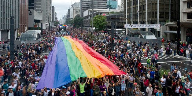 A huge rainbow flag is carried during the annual Gay Pride Parade in Sao Paulo, Brazil, on June 02, 2013. According to organi