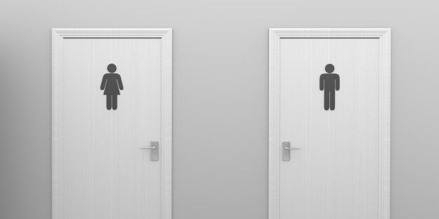 Two closed restroom doors with gender symbol signs designating male and female public toilets.