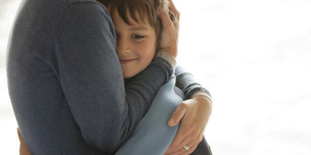 Mother and son hugging