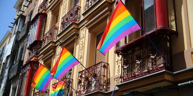 Rainbow flags hanging from the balconies of an old house in the Chueca neighborhood of Madrid, in occasion of the 2014 gay pr