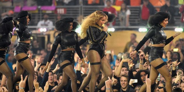 SANTA CLARA, CA - FEBRUARY 07:  Beyonce (R) performs onstage during the Pepsi Super Bowl 50 Halftime Show at Levi's Stadium o
