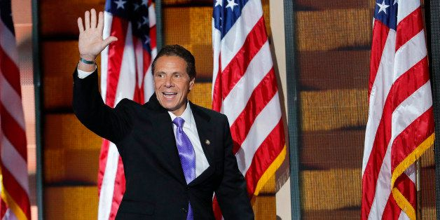 Gov. Andrew Cuomo, D-NY, waves to delegates as he walks on stage during the final day of the Democratic National Convention i