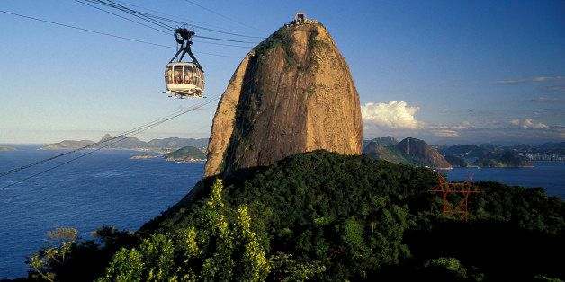 RIO DE JANEIRO, BRAZIL - 2015/10/04: Frontal view of Sugar Loaf cable car and mountain, urban forest, entrance of Guanabara B