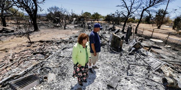 OAK HILLS, CA - AUGUST 19: Miguel and Mabel Ramos, both 73-year-old, are traumatized by the devastation caused by Blue Cut Fi