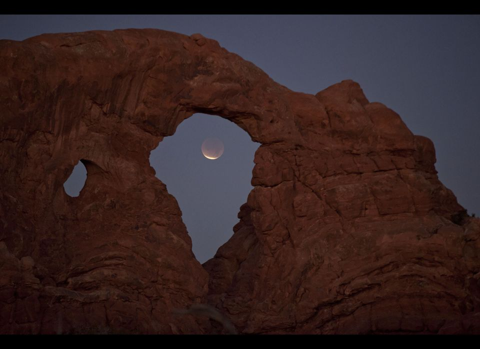 <em>From AP:</em> A lunar eclipse is seen framed within Turret Arch at Arches National Park, Saturday, Dec. 10, 2011, near Mo